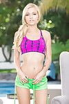Light-complexioned cutie Alex Grey posing non nude in shorts and sports bra outdoors
