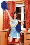 Teenage latina cheerleader taking lacking the brush uniform and fingering the brush slit