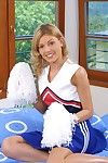 Smiley cheerleader undressing with the addition of exposing her slit in close surrounding