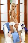 Frisky blonde cheerleader getting unclad and exposing her slim curves