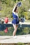 Solo babe Jodi Taylor shucking cheerleader uniform outdoors