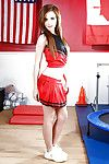 Sexy cheerleader Emma Stoned is presented in sexy red uniform
