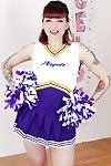 Tattooed schoolgirl cheerleader undresses for minimal cunt circulation