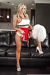 Sexy babe cheerleader Tasha Reign is posing on touching defoliate boobies