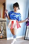 Teeny Oriental cheerleader May Lee beaming black panties under piece of baggage