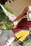 Beautiful tot Jenna Rose posing in a cheerleader outfit
