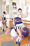 Busty young cheerleader Sensual Jane flashing large natural knockers