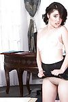 Young schoolgirl Cadence Carter posing on touching skirt and knee cavalier blanched socks
