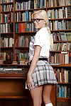 Blonde Euro chick Candee Licious hikes schoolgirl catholic to flash undergarments