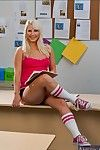 Blond coed babe Kimmy Olsen shows their way shaved pussy leaving socks on