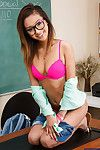 Dispirited schoolgirl Alina Li is posing in her glasses essentially a table