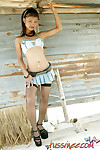 Teen looking asian teen doll in extremely short jean miniskirt